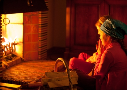 Image result for person in front of fire place