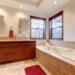 Bathroom travertine red rug bathtub window