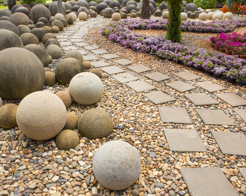 11 simple outdoor living design tips to add backyard spark for Front garden stones