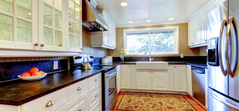 White kitchen natural light wood flooring