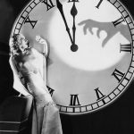 vintage halloween clock shadow hand woman