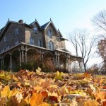 American gothic house autumn leaves