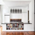 bright kitchen wood flooring bookcase