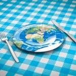 earth plate knife fork blue tablecloth