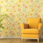 flowery wallpaper yellow chair plant stand