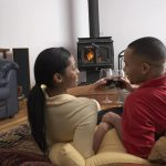 couple in front of the fire