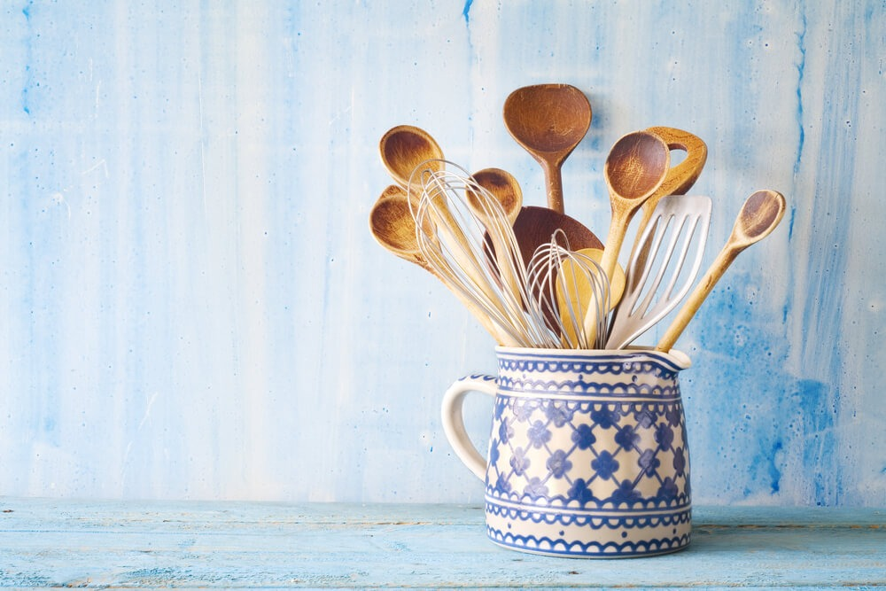 Kitchen Utensils In A Blue Cup Blue Background