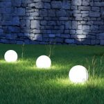 outdoor lighting orbs grass wall