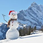 snowman and mountainside