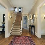 staircase foyer area rug wood flooring