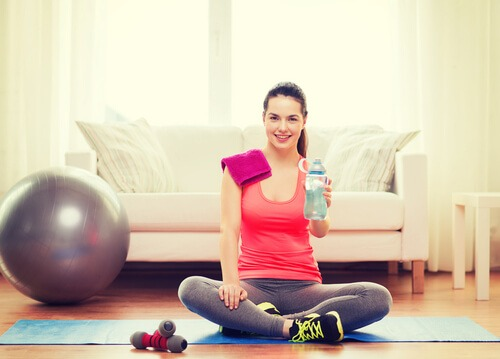 exercise at home woman couch living room wood floor