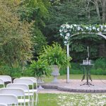 backyard wedding arch folding chairs