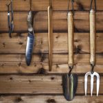organized garden shed tools wood paneling