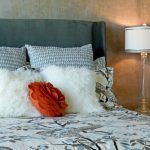 red orange accent pillow white bedding