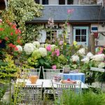 small outdoor living space dining flowers garden