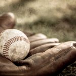 baseball glove and ball on ground vintage