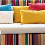 colorful patterned pillowes sofa close up