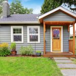small home grey wood deck front yard