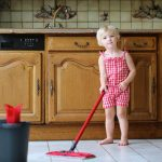 toddler mopping kitchen floor