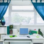 home office work space blue curtains