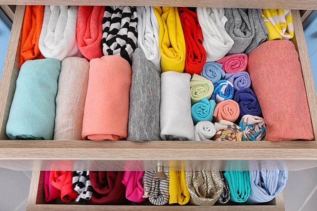 neatly folded clothes in drawers