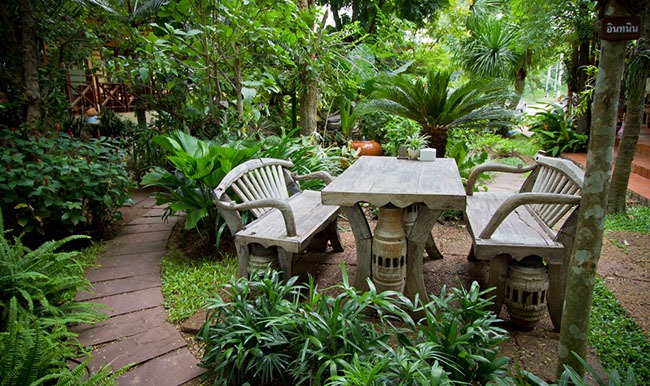 patio furniture in lush trees