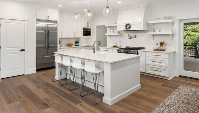 white kitchen with wood flooring