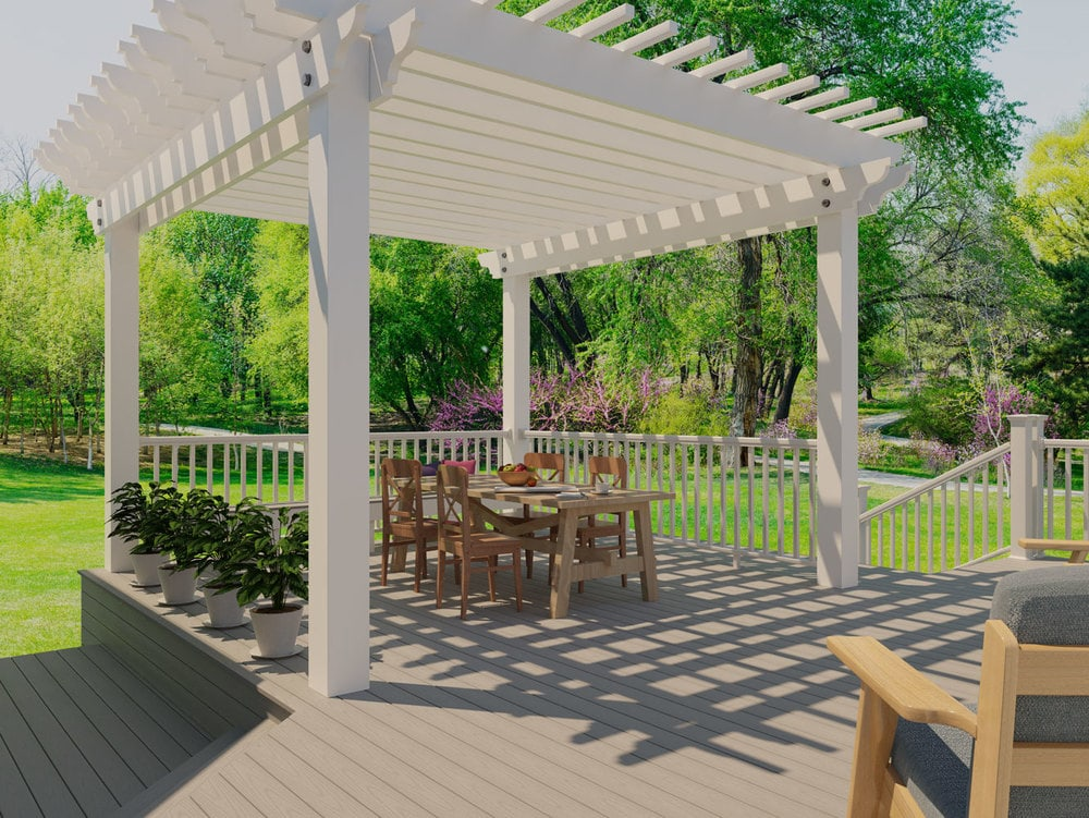 backyard deck with gray composite decking and white pergola