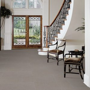 Concrete-look tiles add elegance to an entrance.