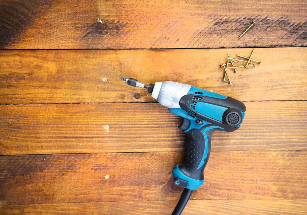 drill-on-hardwood - How To Fix A Squeaky Hardwood Floor