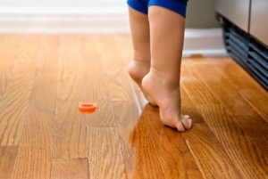 Child on hardwood floor