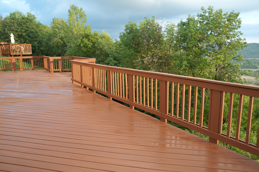 freshly-stained-wood-deck-with-railing