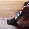 paint-brush-staining-hardwood