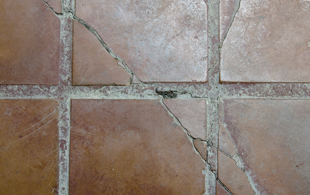 How to hide or repair cracked tiles in your home for Cracked bathroom tile repair