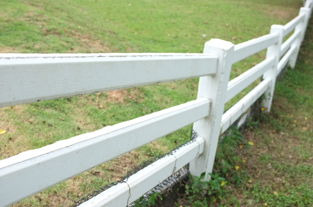 white-fence-on-hill