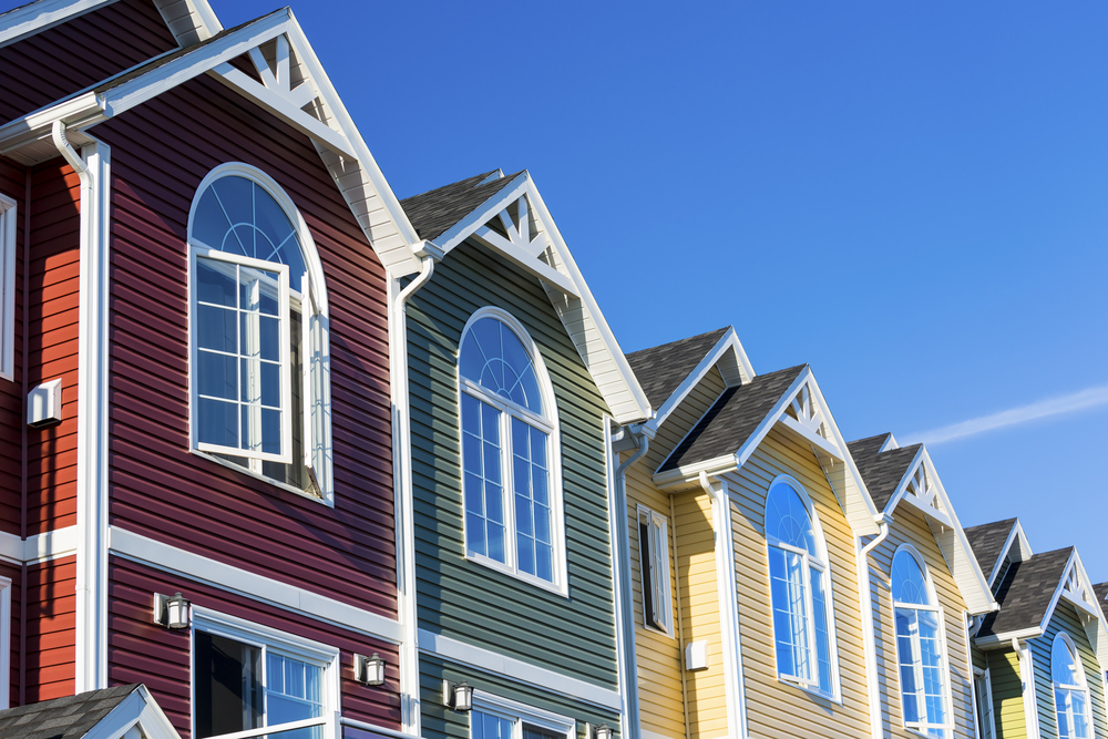 row-houses-colorful-vinyl-siding exterior painting tips