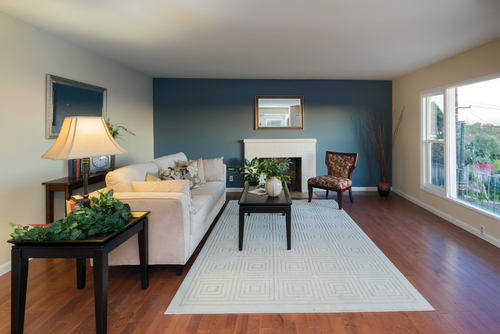 refined living room blue accent wall wood flooring