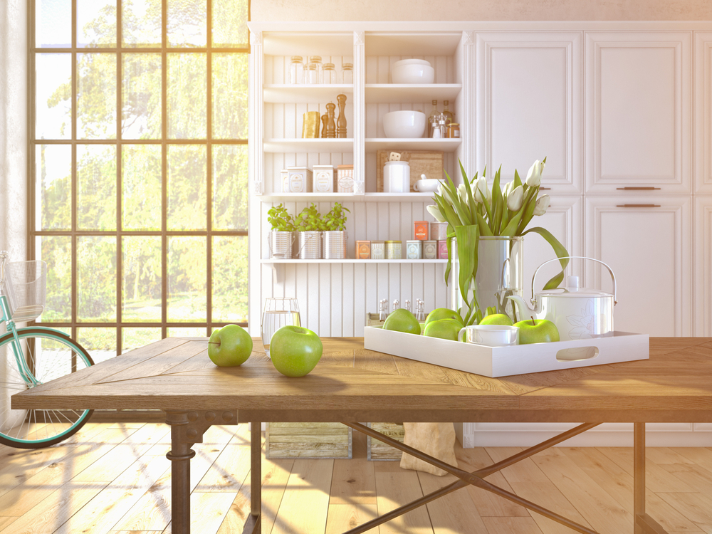 bright kitchen and pantry with apples and plants on the table