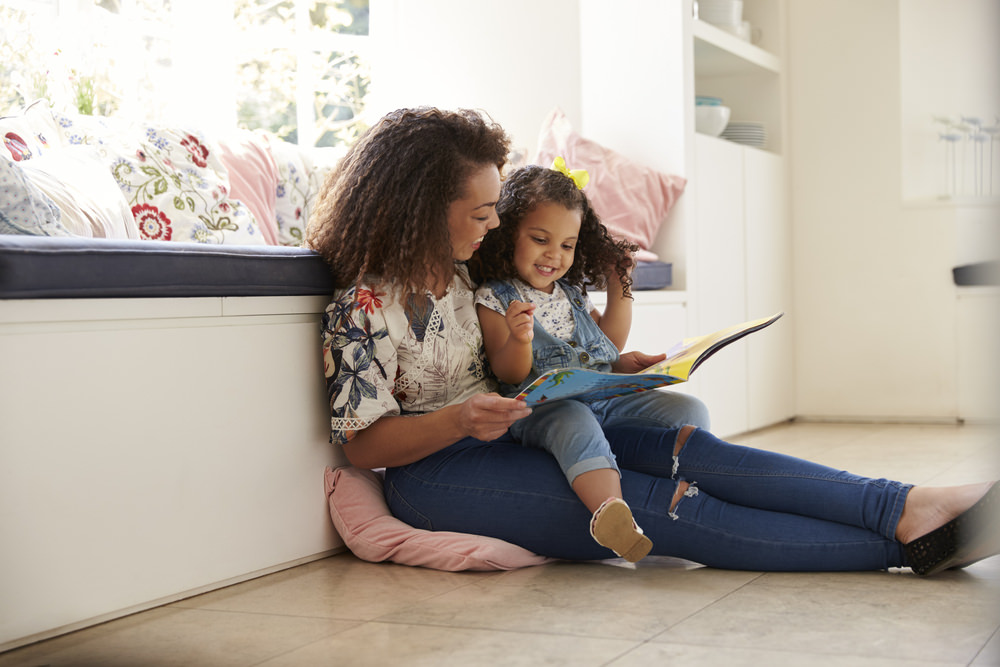 mother reading with daughter