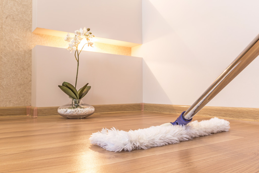 sweeping wood floors