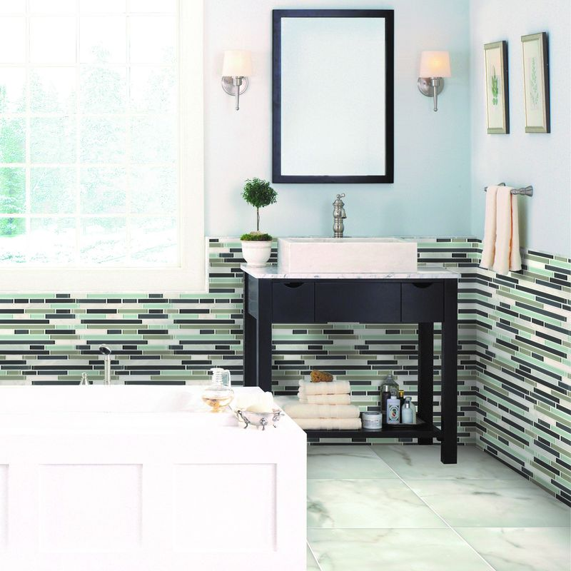 Featuring Cabot Marble Tile in Calacatta Gold.
