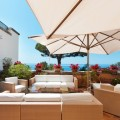 From commercial to private properties, patio umbrellas can provide shade.