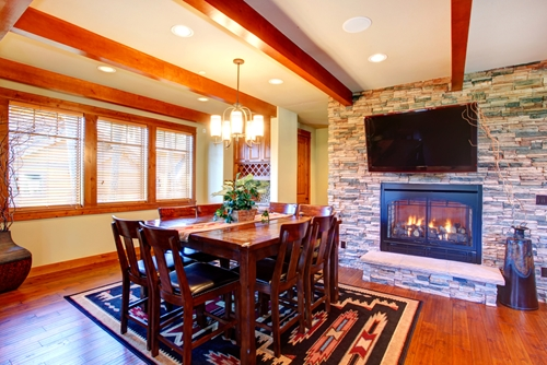 Manufactured stone veneer always looks great surrounding your fireplace.