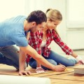 There are pros and cons for installing floors or cabinets first.